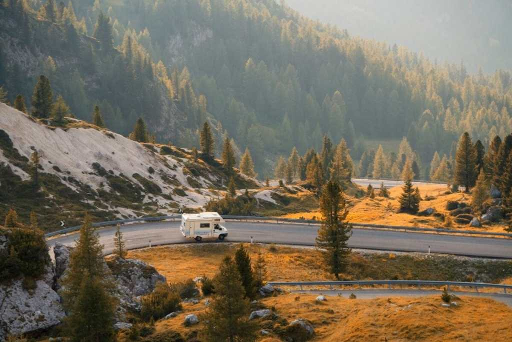 Van on a mountain road at sunset