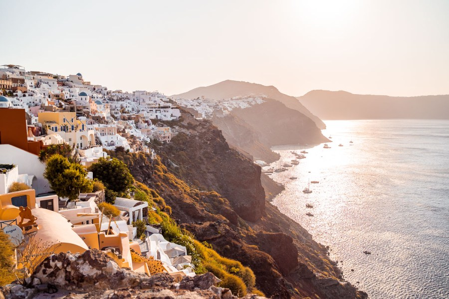 View of the caldera at sunrise from Oia Castle in Santorini