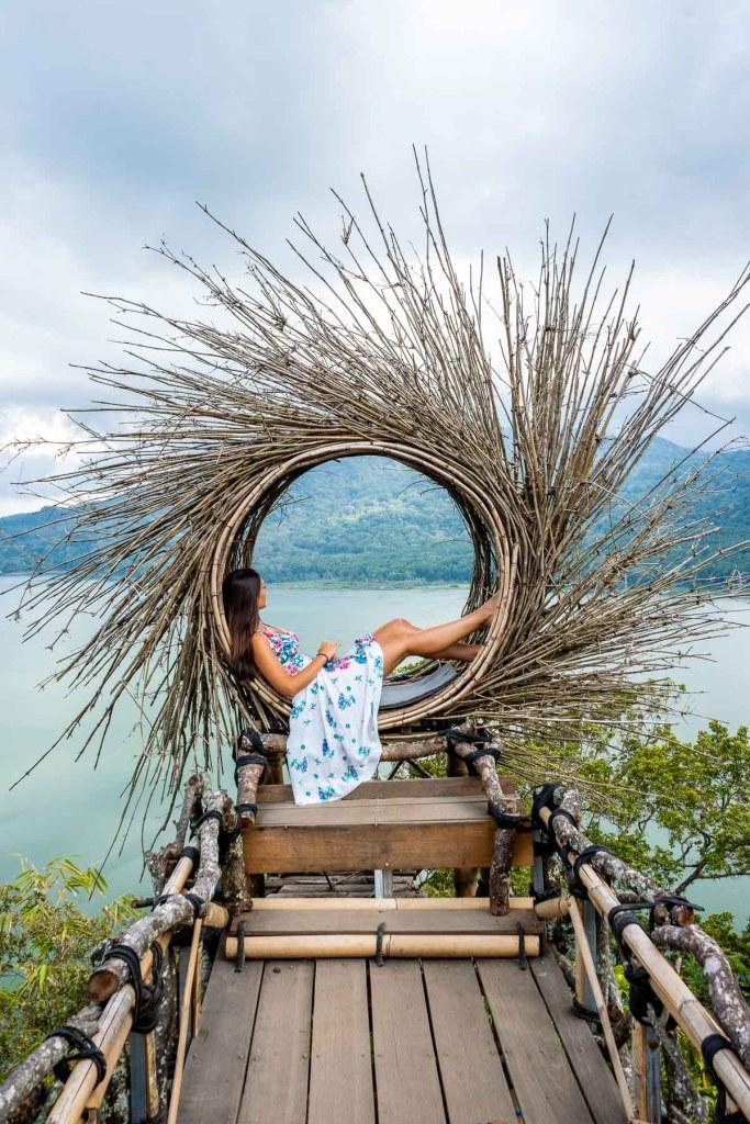 Girl sitting in a bamboo lookout at Wanagiri Hidden Hills in Bali