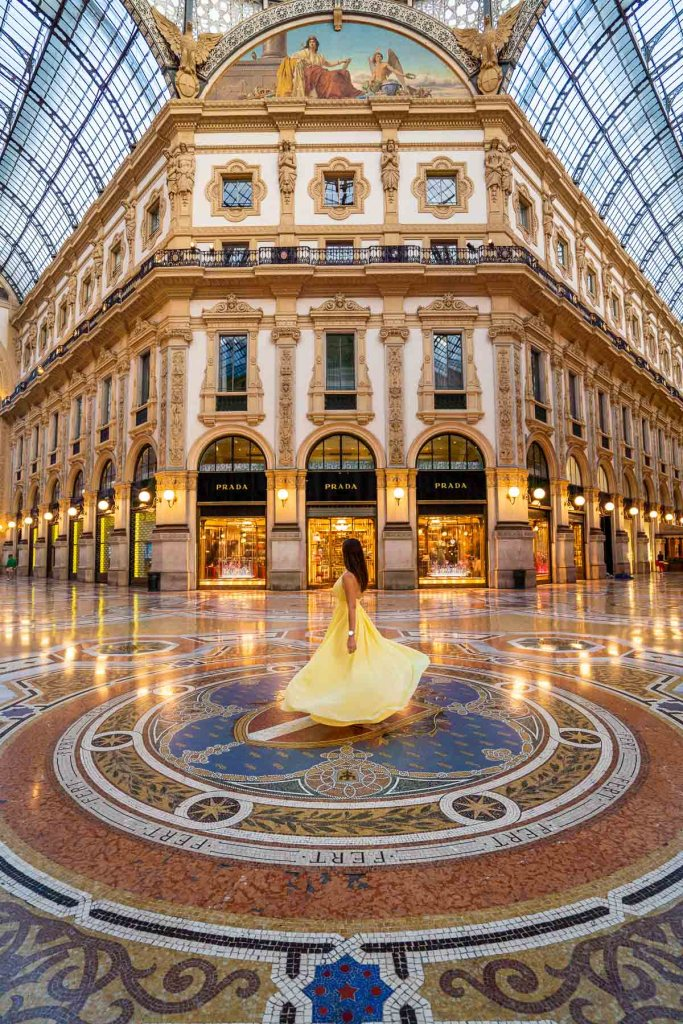 Girl in a yellow dress twirling inside the Galleria Vittorio Emanuele in Milan, Italy