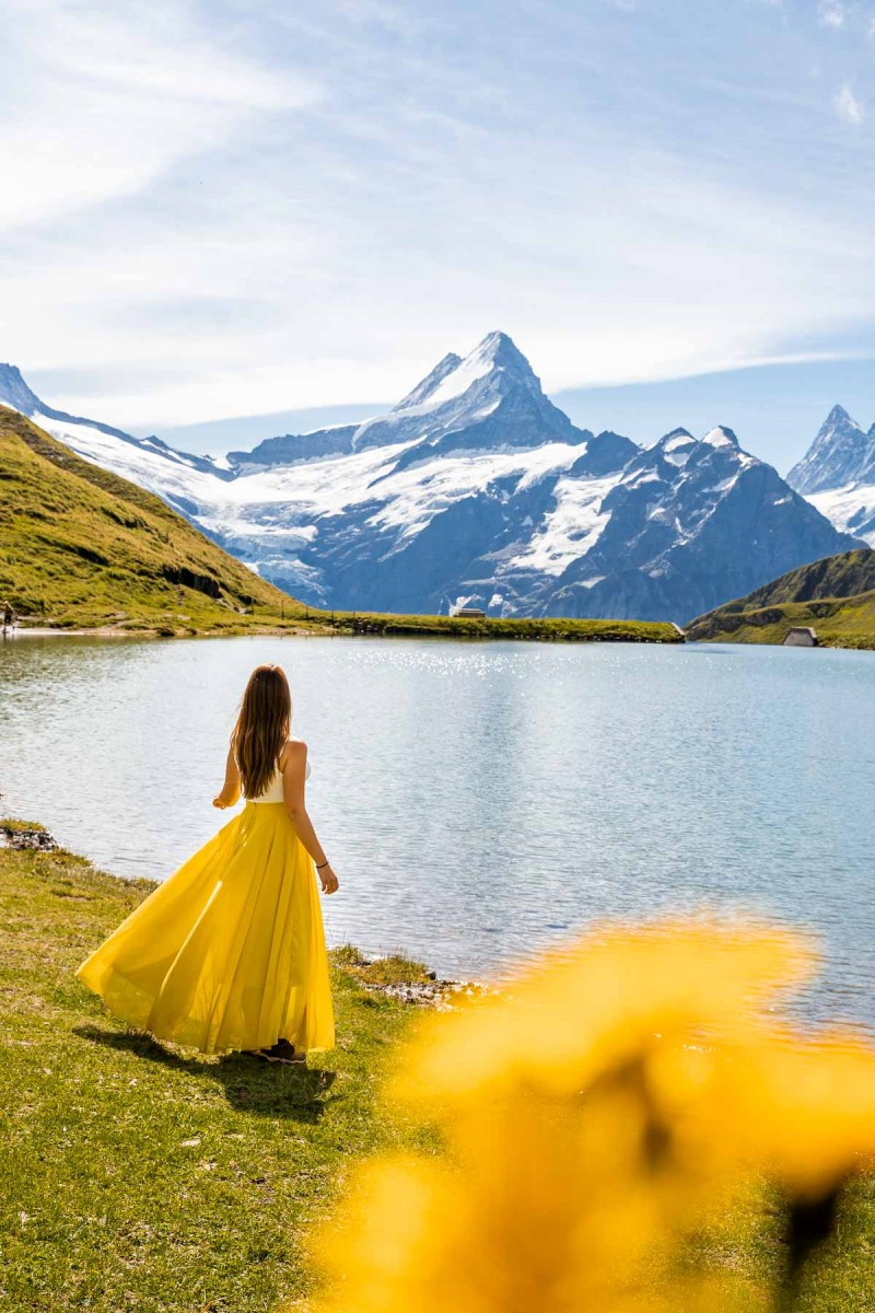 Girl in a yellow dress in front of Bachalpsee, Switzerland