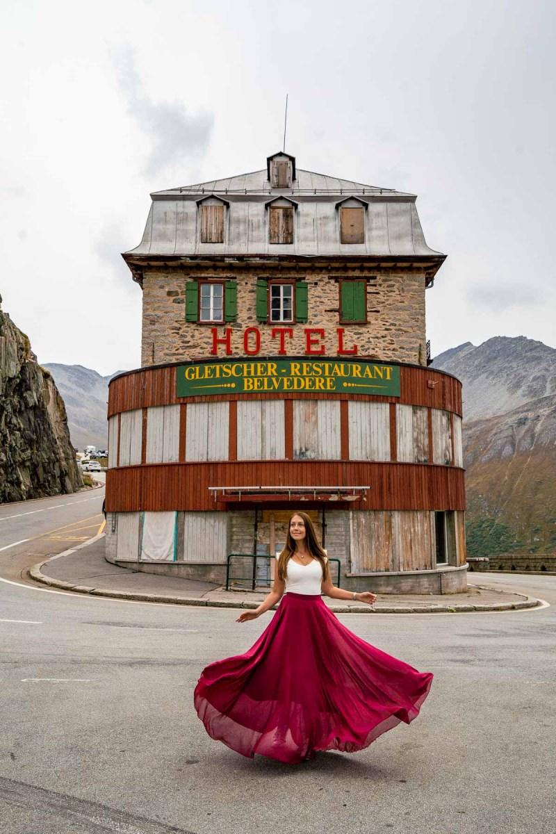 Girl in a red skirt in front of Belvedere Furka, Switzerland