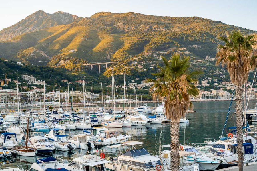 Yachts on the water in the harbor of Menton