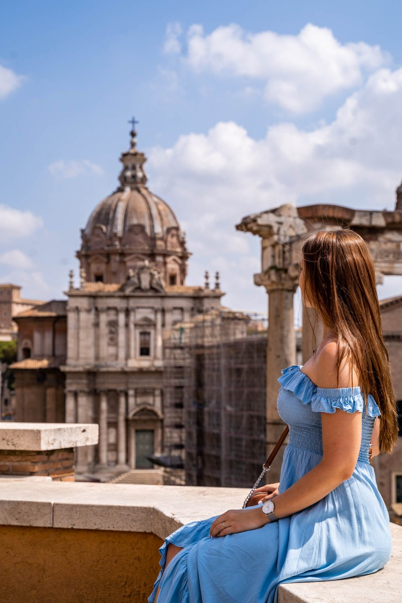 Girl in a blue dress at Punto Panoramico del Foro Romano, Italy