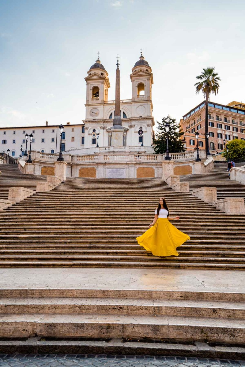 Girl in a yellow skirt on the Spanish Steps, which is one of the best Rome Instagram spots