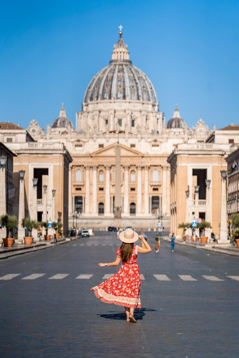Girl in a red dress in front of St. Peter's Basilica, Vatican City