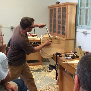 Carving the under side of the seat with a draw knife.