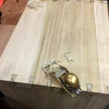 Trimming down the dovetail ends.