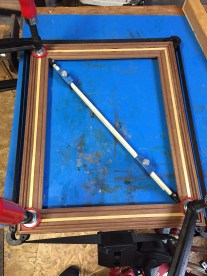 Then I used my pinch sticks to make sure the frame is square.