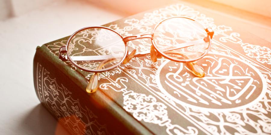 Очки на Священном Коране