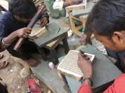 Men carving the blocks for printing in Sanganer.