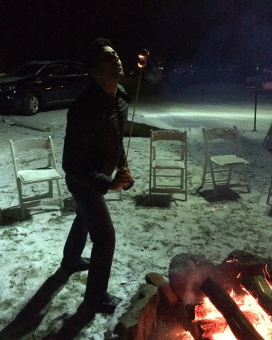 Roasting marsh-mellows over a campfire