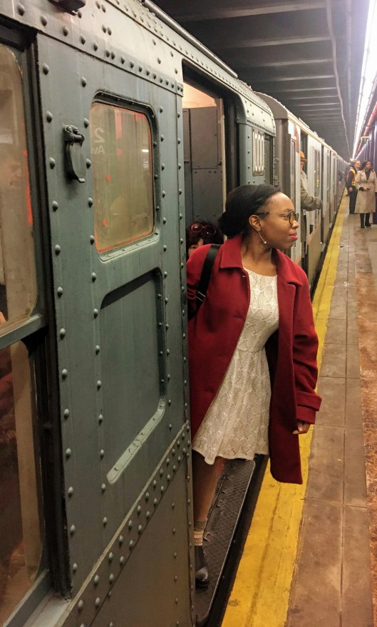 MTA Holiday Nostalgia Train Ride, girl looks out train, subway doors