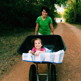 wheelbarrow rides with Micah are a summer norm for Emmi!