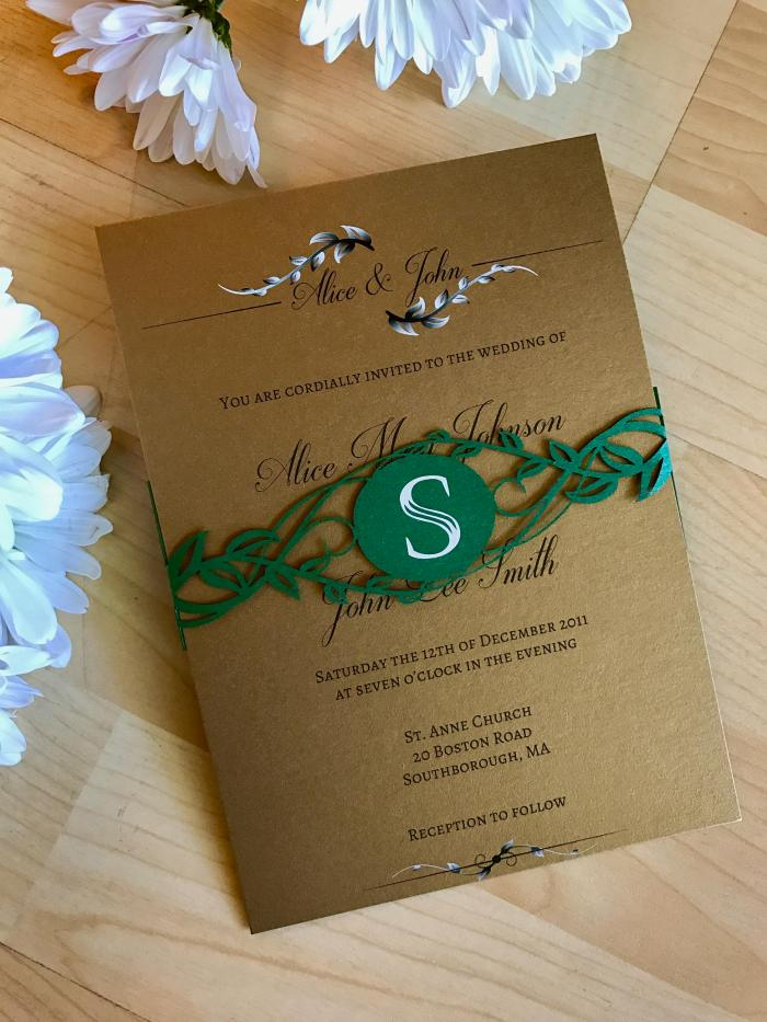Greenery wedding invitation with laser cut belly band custom monogramed leaves and vines modern chic