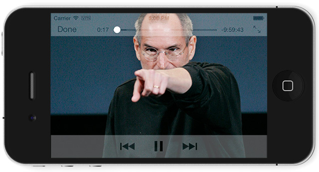 An iPhone 4 playing a video of Stephen Jobs pointing menacingly