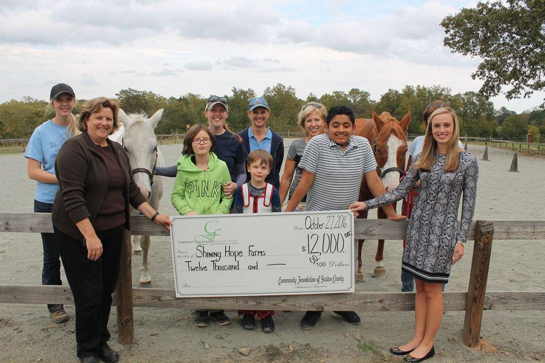Shining Hope Farms' Team Receives Check