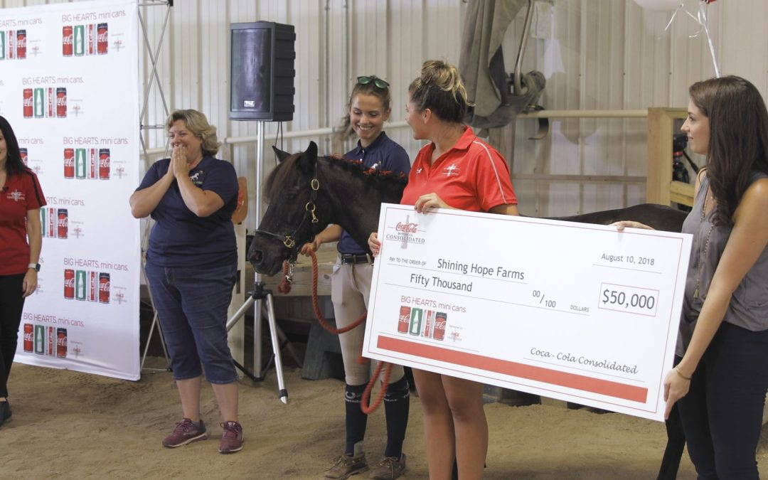 Press Release: Coca-Cola Consolidated Surprises Shining Hope Farms with $50,000 Gift and Commercial to Air Nationally During the World Equestrian Games