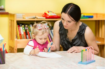 Montessori Teacher and Child
