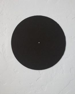 Back of piece finished in black felt.