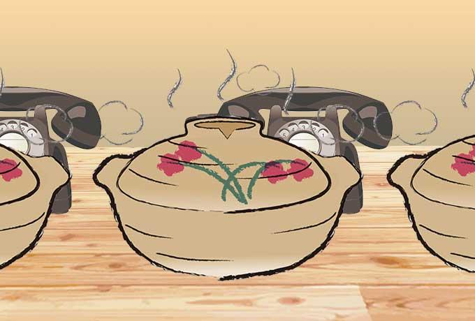 鍋の向こうの電話機