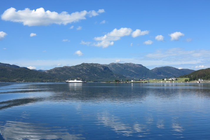 A time for reflection: A ferry shuttles between two islands in Lysefjord