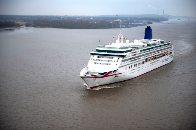 Flying the flag: Aurora leaving Hamburg in its new Union Flag livery (Picture: P&O Cruises)