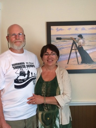 Ronnie and Deb in front of Deb's favorite picture in the house: it reminds her of herself, looking out to sea and waiting for him to come home.
