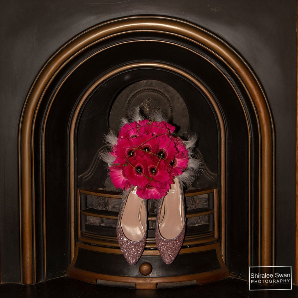 A bouquet of Pink Gerberas with the Brides pink sparkly shoes