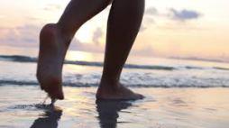 feet walking in beach