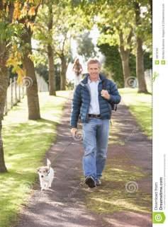 man-walking-dog-outdoors-autumn-park-13673763[1]
