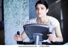 stock-photo-woman-riding-an-exercise-bike-in-gym-doing-sport-biking-in-the-gym-for-fitness-cardio-and-fat-loss-278643989[1]
