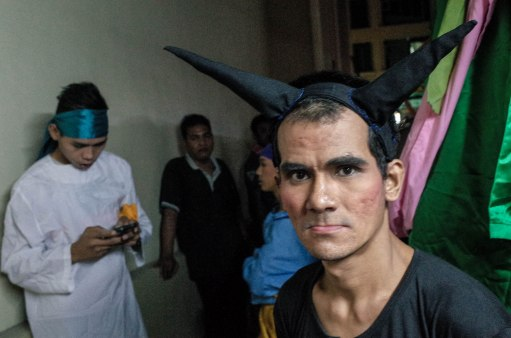 """During the first intermission, I tried to talk to some of the characters in the play. I met the Southeast Asian incarnations of Judas, Mary, and the Apostles. I spoke to a wiry man dressed in black. He had a headband with two horns and a long tail connected to his dark pants. It was the devil himself, cigarette in hand. """"We are all descendants of the original members. As long as we can, we will continue."""""""