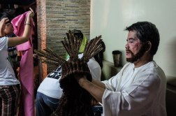 """""""I've played Jesus for almost 20 years, it is my vow,"""" said a retired nurse named Jun Taytay. I sat next to Jesus. A rickety fan was placed close to his face to help dry his woolly beard. His thick wig barely moved with the wind. He told me that a year ago he could barely walk—a back injury had left him partly immobile. He lifted his robe to reveal a metal brace strapped around his waist. I asked how his back felt today. """"Great!"""" he said as he stood to return to the stage. """"With faith, nothing is impossible."""""""
