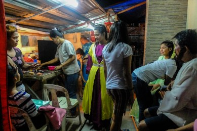 People of all ages, shapes and sizes take part in Malibay's Passion play. A group of make-up artists work in a frenzy to prepare the actors.
