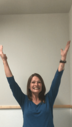 Shirley Allred with hands in the air. Success at Different Dimension Acres