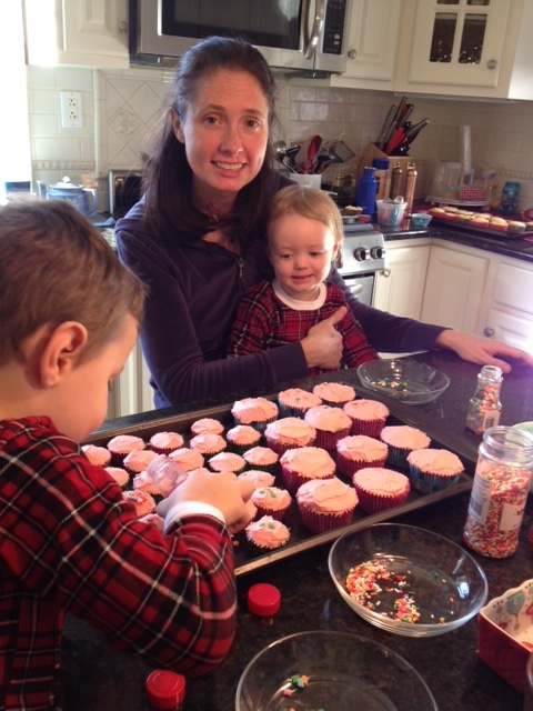 Helping Mommy decorate the cupcakes