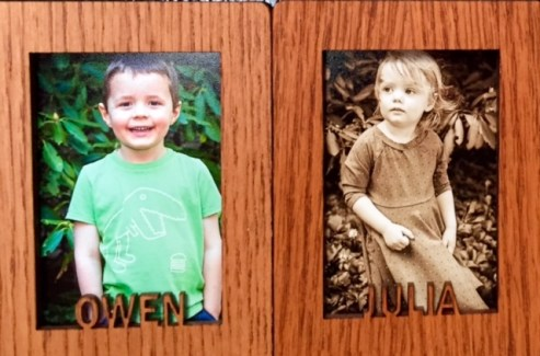 photos of grandchildren Owen and Julia displayed on our fridge