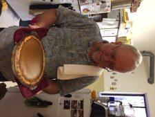 Father Dunstan examines the loveliest of his pumpkin pies.