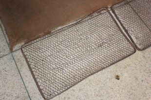 Net wire mat in the entrance of library