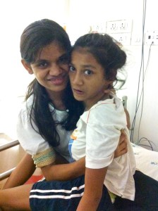 Ganga and her Didi in the Emergency Room. Ganga was alternatively angry, frightened, and thrashing about.