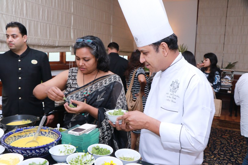 Chef Alok Verma and Ms. Sangeeta Khanna catch up on a quick chat over the green hi-tea spread