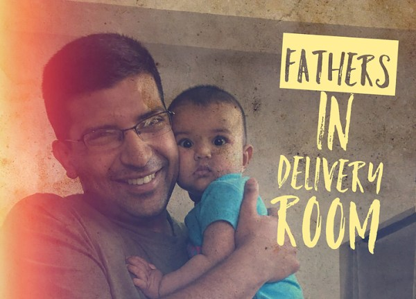 fathers in delivery room at childbirth