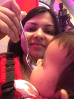 babywearing-mom-feeding-child-in-ssc-at-johnsons-and-johnsons-event-india