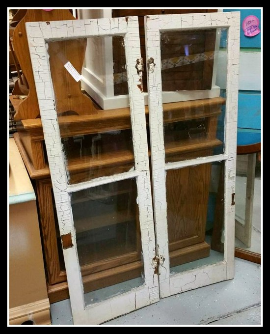 Antique pair of chippy white glass french windows