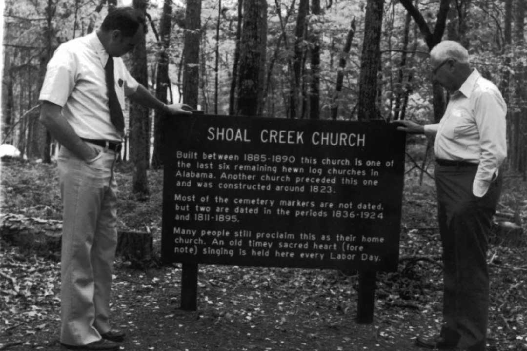 A sign on the Pinhoti Trail just above the cemetery was place in the early 1970's. Note that there are two errors at the bottom: Sacred Harp is four note (or part) music.