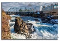 Water flows through the Spokane Falls in downtown Spokane, Washington.