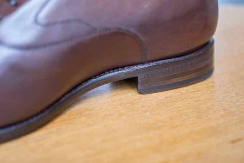 Arch of the shoe where the sole edge is even more close-cut.