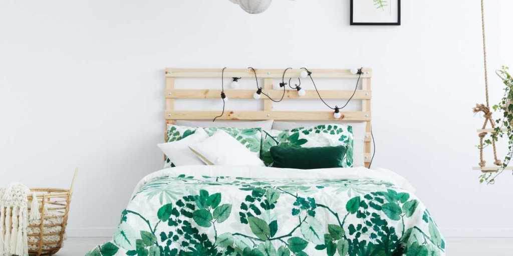 bed with green floral bed spread