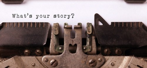 """Typewriter typing the words """"What's your story?"""""""